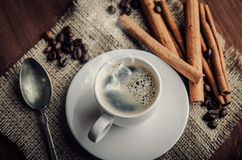 Coffee. Warm cup of coffee on brown background Royalty Free Stock Photo