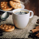 Coffee. Warm cup of coffee on brown background stock photos