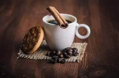 Coffee. Warm cup of coffee on brown background Royalty Free Stock Photography