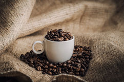 Coffee. Warm cup of coffee on brown background stock photo