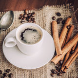 Coffee. Warm cup of coffee on brown background stock images