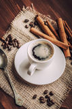 Coffee. Warm cup of coffee on brown background royalty free stock image