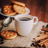Coffee. Warm cup of coffee on brown background royalty free stock photos
