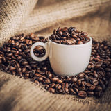 Coffee. Warm cup of coffee on brown background Royalty Free Stock Images