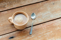 Coffee. A cup of coffee with wood background Stock Photo