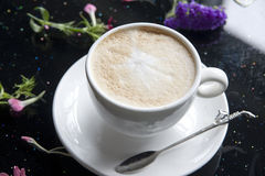 Coffee. The coffee flowers dotted its utensils Royalty Free Stock Image