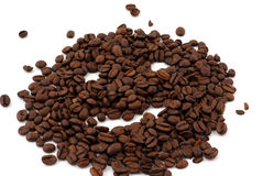 Coffee. Brown coffee beans in front of a white background Stock Photos