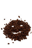 Coffee. Brown coffee beans in front of a white background Stock Images