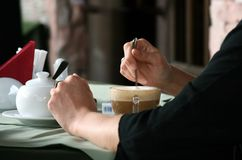 Coffee. The woman drinks coffee at restaurant Royalty Free Stock Photos