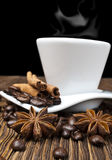 Coffee. Hot coffee with spices on a wooden table Royalty Free Stock Photos