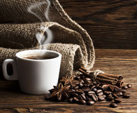 Coffee. Hot coffee with spices on dark wooden background Royalty Free Stock Photos