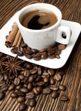 Coffee. Hot coffee with spices on a wooden table Royalty Free Stock Image