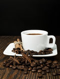 Coffee. And spices on a wooden table Royalty Free Stock Image