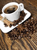 Coffee. Hot coffee with spices on a wooden table Stock Image