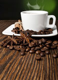 Coffee. Hot coffee with spices on a wooden table Stock Images