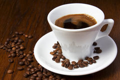 Coffee. A cup of fresh black coffee against background of roasted coffee beans Stock Photo