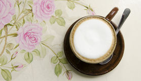 Coffee. Cup of coffe with flower on elegant wooden background Stock Photo