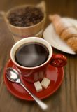 Coffee. Cup of black coffee with croissant close up Stock Photos