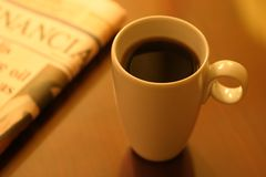 Coffee. A cup of coffee and a newspaper Royalty Free Stock Photography