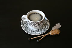 Coffee. White and black coffee cup with sugar crystals Stock Photo