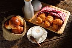 Coffee. A cup of cappuccino and bread royalty free stock photography