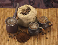 Coffee. Images; still life of ; organic ;  in a cezve; fresh ; hot ;  beans;  ground;  cups Stock Photography