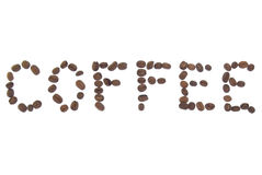 Coffee. Text made with beans on white background royalty free stock images