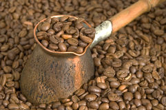 Coffee. Turkish coffee pot and coffee beans Royalty Free Stock Photos