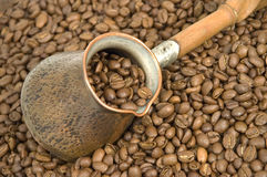 Coffee. Turkish coffee pot and coffee beans Royalty Free Stock Image