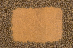 Coffee. Coffee in grains on a brown background Stock Photography