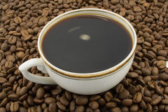 Coffee. Cup of coffee and coffee beans close-up Royalty Free Stock Image