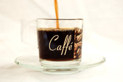 Coffee. An image of coffee being poured into a coffee cup stock image