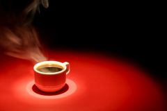 Coffee. Cup over red black background Stock Images