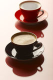 Coffee. Two cups of coffee, red and black stock photography