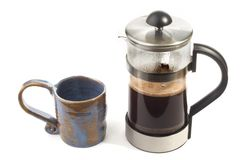 Coffee. A blue mug and a pot of coffee Royalty Free Stock Photos