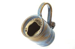 Coffee. A blue mug full of coffee on white backgrond Stock Photo