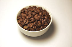 Coffee. Beans in the cup Royalty Free Stock Image