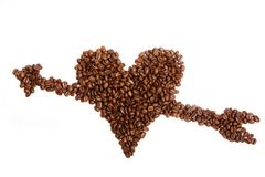 Coffee. Beans in shape of heart with arrow isolated on white stock image