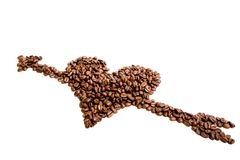 Coffee. Beans in shape of heart with arrow isolated on white royalty free stock photo