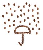 Coffee. Umbrella and rain made of coffee beans stock images