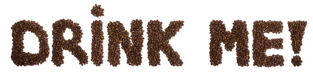Coffee. Phrase drink me! made of coffee beans stock photography