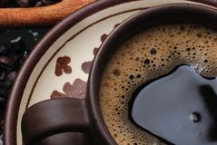 Coffee. Close up of a mug with a coffee beans Royalty Free Stock Image