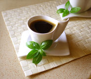 Coffee. Black coffee with basil leaflets on top royalty free stock images