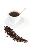 Coffee. Cup of coffee and coffee beans on a white background Stock Image