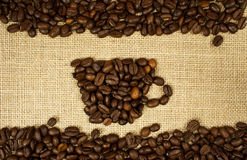 Coffee. Cup of coffee on burlap Royalty Free Stock Image