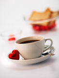 Coffee. White cup with coffee and one chocolate Stock Image