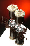 Coffee. Two glasses of coffee with cream and coffee beans stock image