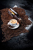 Coffee. Cup of coffee, beans and glass bottle royalty free stock photo