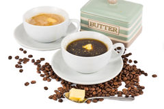 Coffee with added butter, black and with milk.  stock photography