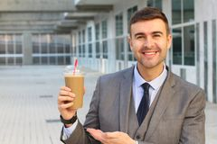 Coffee addict with his latte royalty free stock photography